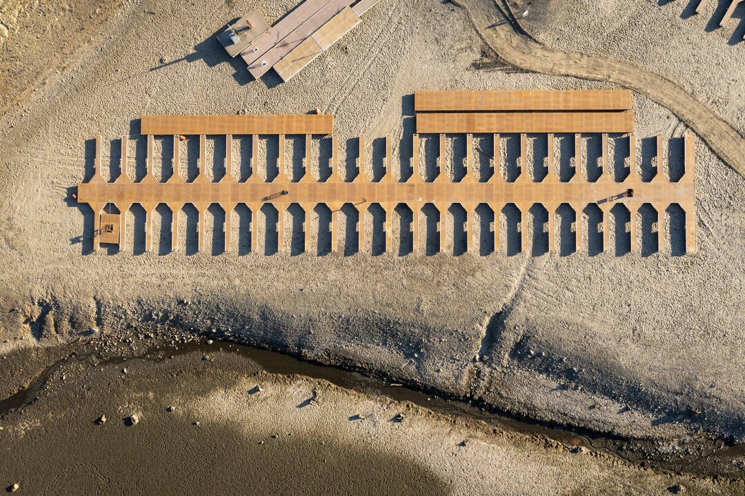 Boat slips lay stranded on dry land as water levels recede at Folsom Lake.