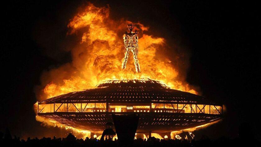 "FILE - In this Aug. 31, 2013, file photo, the ""Man"" burns on the Black Rock Desert at Burning Man ne"
