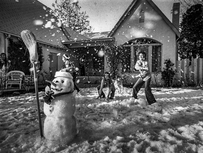 Dec. 25, 1978: After ice machines finish their work, members of the Ricoletti family have a snowball fight.