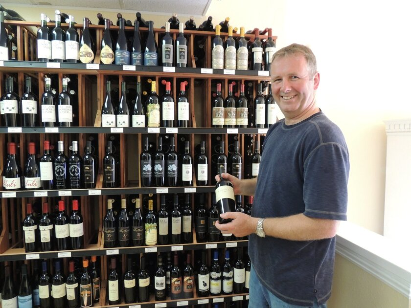 "Ken Chalmers, owner of Bird Rock Fine Wine, doesn't organize his wine by price because he said everything is ""hand sold."""