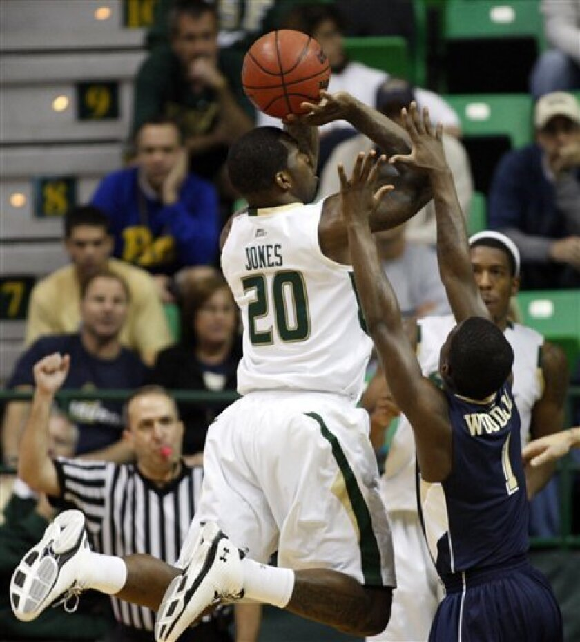 South Florida's Dominique Jones (20) is fouled on a shot by Pittsburgh's Travon Woodall during the first half of an NCAA college basketball game Sunday, Jan. 31, 2010, in Tampa, Fla. (AP Photo/Mike Carlson)