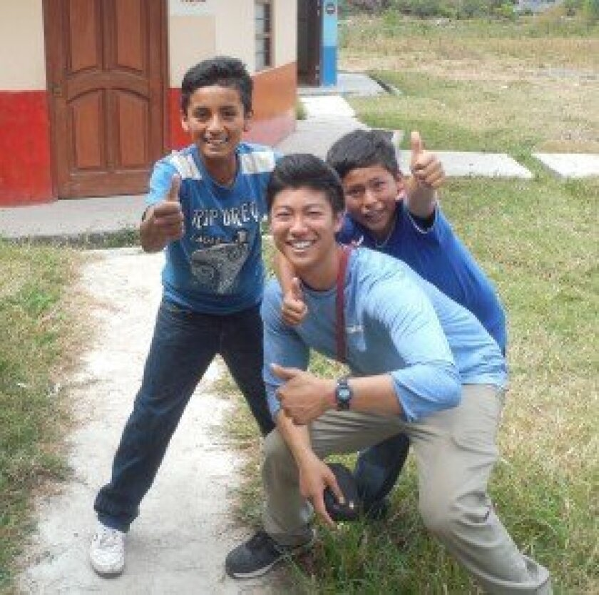 CCA junior Jordan Shimizu with local students in the community of Chiapon in Peru.