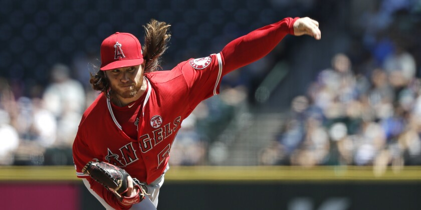 Angels starter Dillon Peters delivers during the first inning of a 9-3 victory over the Seattle Mariners.