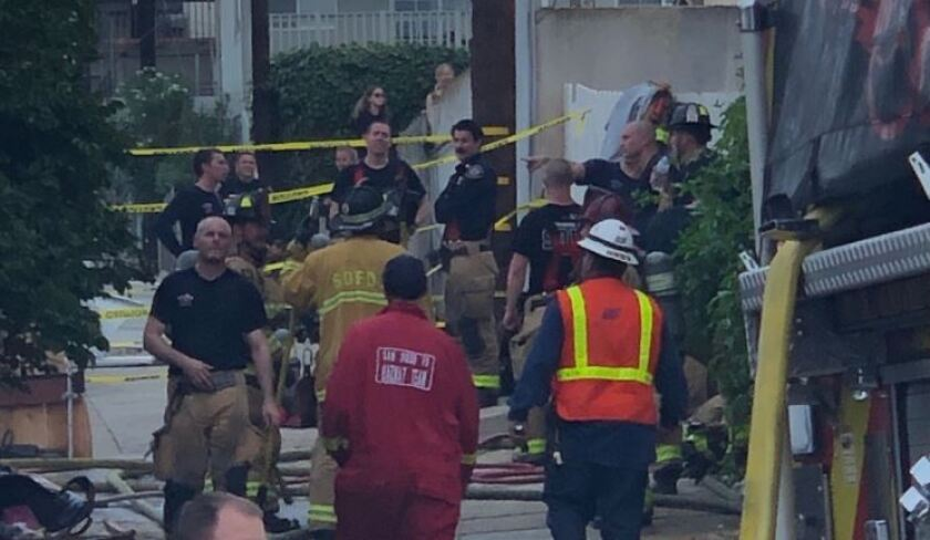 A fire destroyed the garage and work space of an Ocean Beach surfboard craftsman on Tuesday.