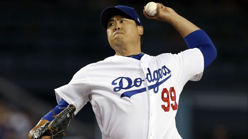 Los Angeles Dodgers starting pitcher Hyun-Jin Ryu throws to a Colorado Rockies batter during the fir