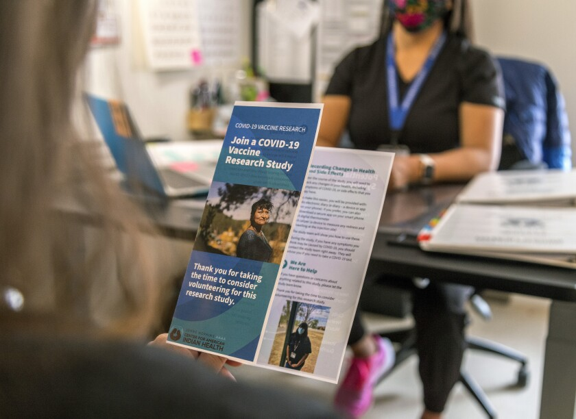 This photo provided by Johns Hopkins Center for American Indian Health shows a brochure that was used to provide information about a COVID-19 vaccine trial on the Navajo Nation, Tuesday, Dec. 29, 2020, in Chinle, Ariz. (Nina Mayer Ritchie/Johns Hopkins Center for American Indian Health via AP)