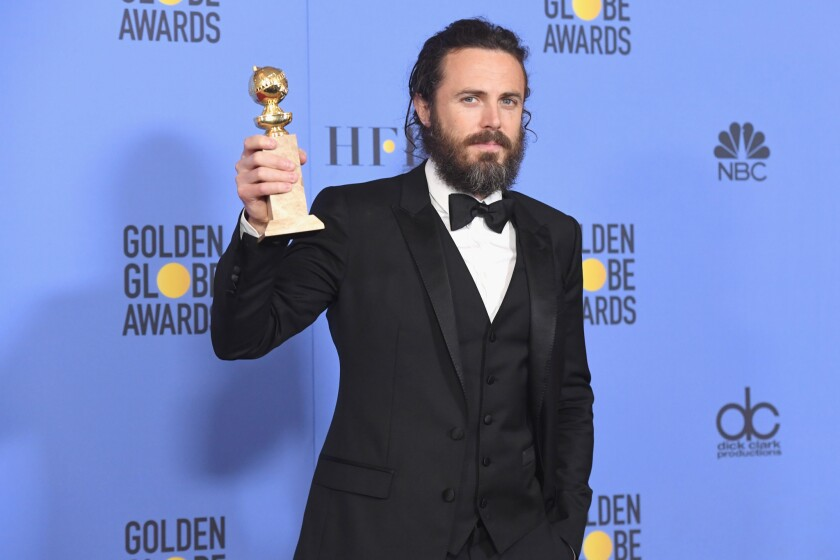 """Casey Affleck with his award for actor in a motion picture drama for """"Manchester by the Sea."""""""