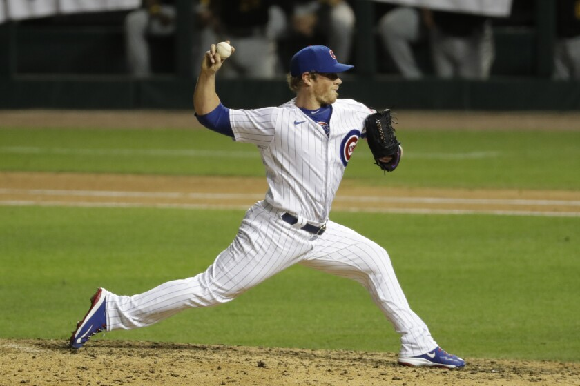 Chicago Cubs closer Craig Kimbrel throws the ball against the Pittsburgh Pirates during the ninth inning of a baseball game in Chicago, Friday, July 31, 2020. The Cubs won 6-3. (AP Photo/Nam Y. Huh)
