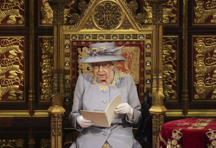 Britain's Queen Elizabeth II delivers a speech in the House of Lords during the State Opening of Parliament at the Palace of Westminster in London, Tuesday May 11, 2021. (Chris Jackson/Pool via AP)