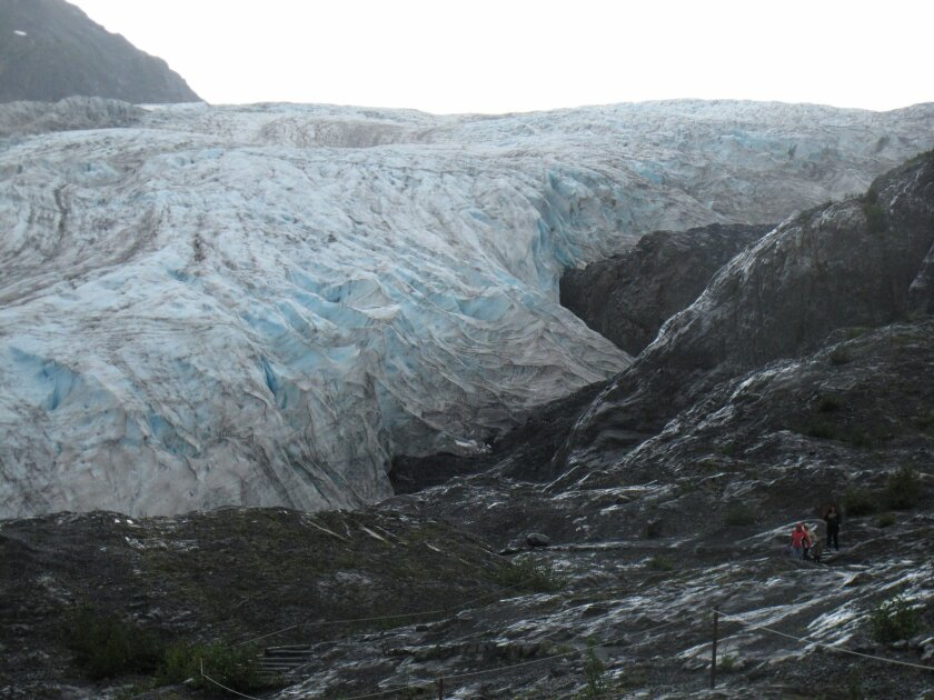 This photo taken Aug. 4, 2012, shows tourists walking to Exit Glacier in Kenai Fjords National Park just outside Seward, Alaska. President Barack Obama will visit Alaska next week to press for urgent global action to combat climate change, even as he carefully calibrates his message in a state heavily dependent on oil. (AP Photo/Mark Thiessen)