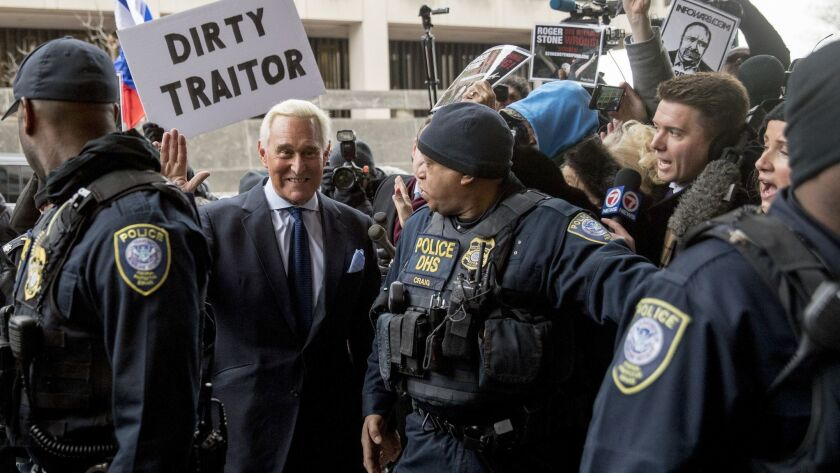 Roger Stone, who advised President Trump for years, arrives at federal court in Washington on Tuesday. He was arrested on Friday in the Russia investigation.