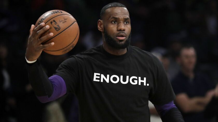 Lakers' LeBron James wears a t-shirt for the 12 victims of Wednesday night's shooting at Borderline Bar in Thousand Oaks before the game against the Atlanta Hawks on Sunday.