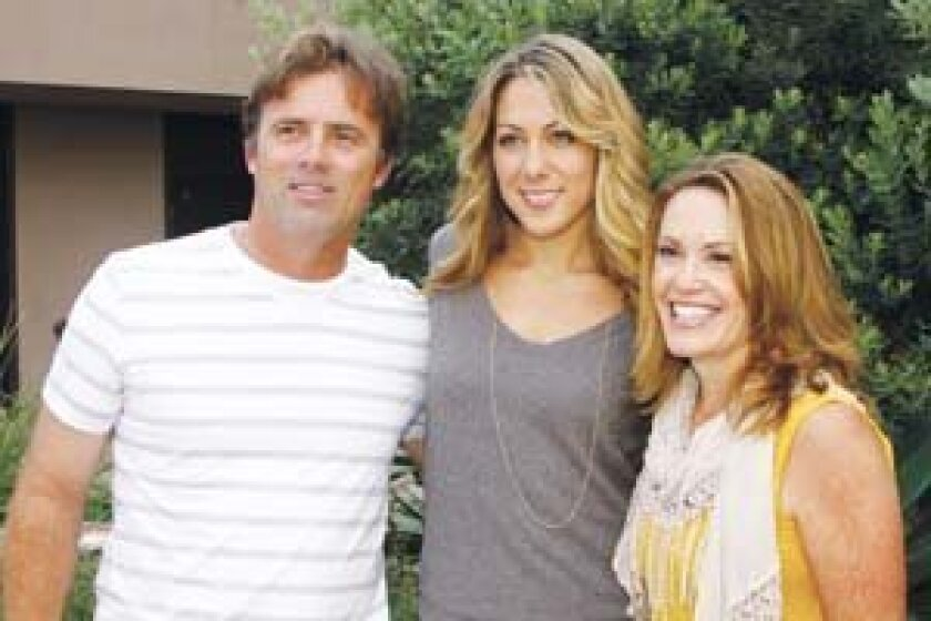 Eric Johnson, singer songwriter Colbie Caillat and Peggy Johnson attend Rock the Cure to benefit children with diabetes.