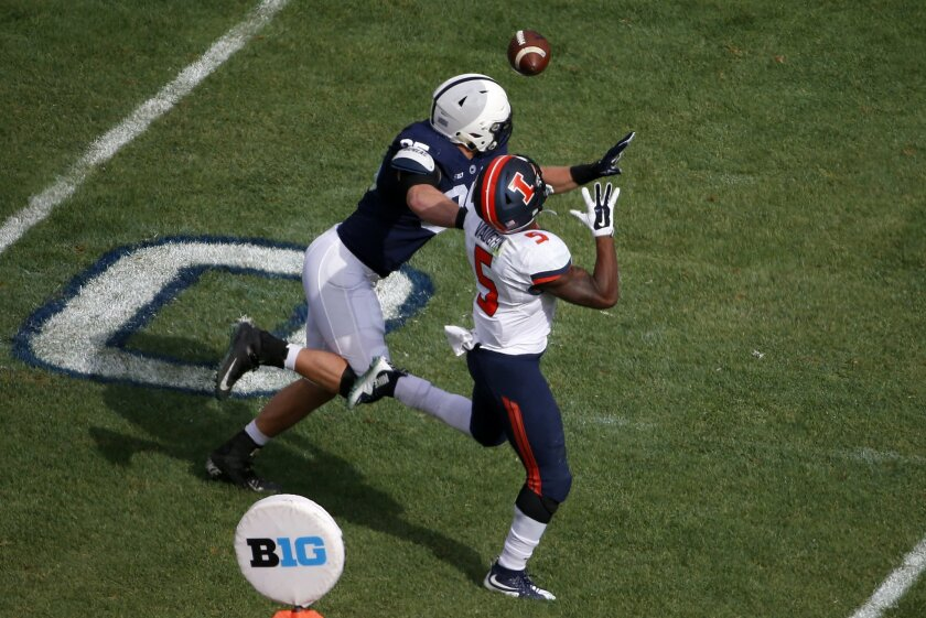 Illinois running back Ke'Shawn Vaughn (5) catches a pass from quarterback Wes Lunt over Penn State defensive end Carl Nassib (95) during the first half of an NCAA college football game in State College, Pa., Saturday, Oct. 31, 2015. (AP Photo/Gene J. Puskar)