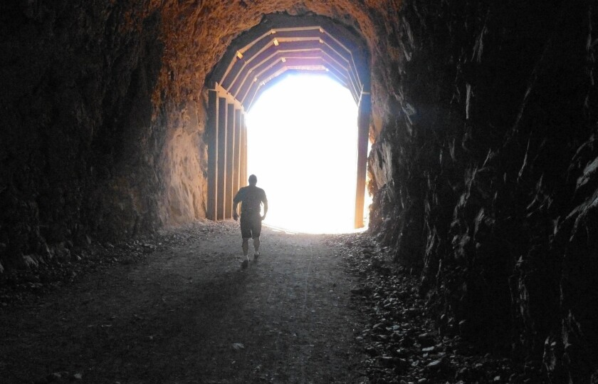 A few short tunnels provide the only shade for miles on the Railroad Trail.
