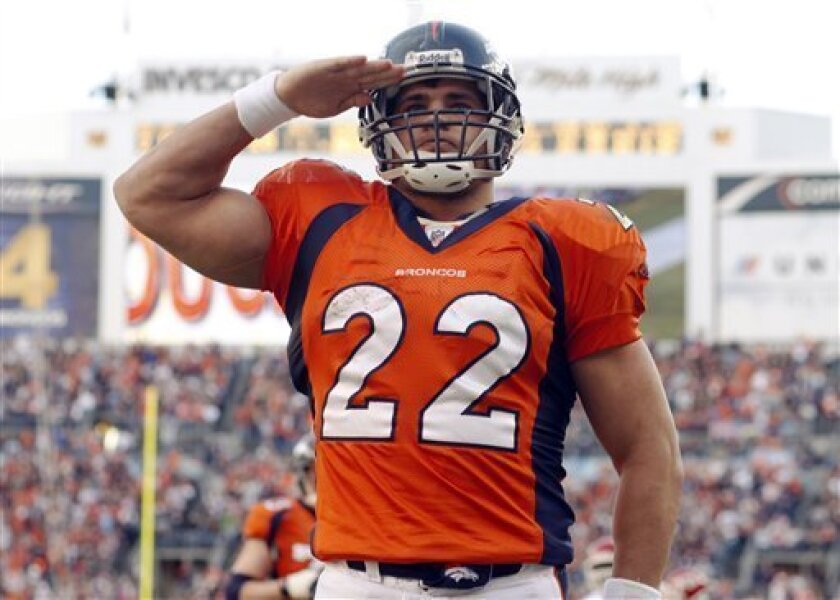 Denver Broncos fullback Peyton Hillis salutes the crowd after running for a touchdown against the Kansas City Chiefs in the first quarter of an NFL football game in Denver on Sunday, Dec. 7, 2008. (AP Photo/David Zalubowski)