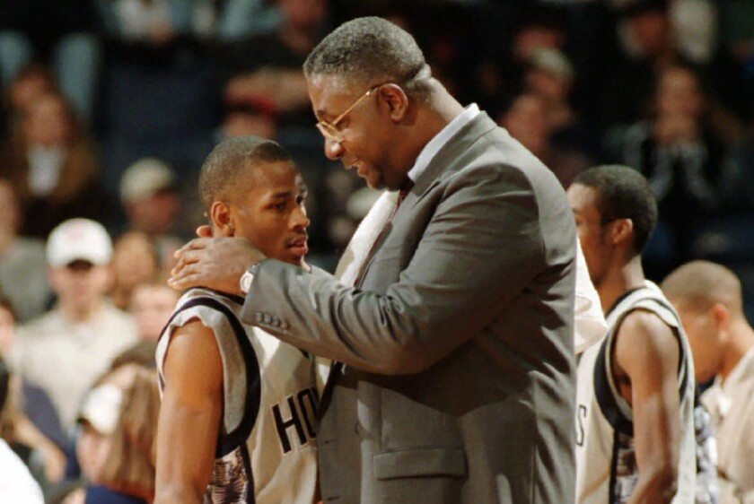 FILE - In this Jan. 24, 1996, file photo, Georgetown head coach John Thompson talks to Allen Iverson during an NCAA college basketball game against St. John's, in Landover, Md. Thompson, the imposing Hall of Famer who turned Georgetown into a basketball powerhouse and became the first Black coach to lead a team to the NCAA men's title, has died at age 78, his family announced through the university, Monday, Aug. 31, 2020. (Porter Binks/USA Today via AP, File)