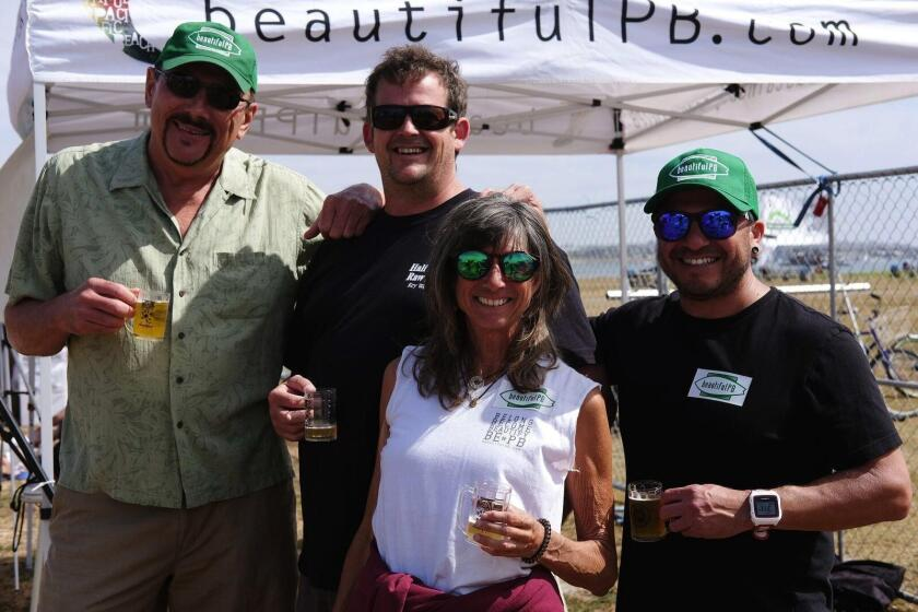 BeautifulPB board members Robert Kunysz, president Matthew Winter, Community Garden coordinator Paula Gandolfo and Rick Menolez