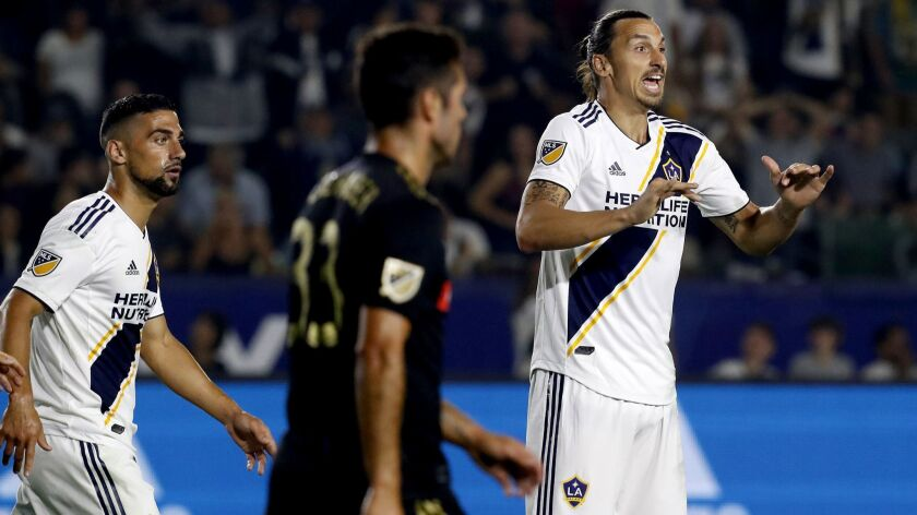 CARSON, CALIF. - AUG. 24, 2018. Galaxy forward Zlatan Ibrahimovic argues with an official that he s