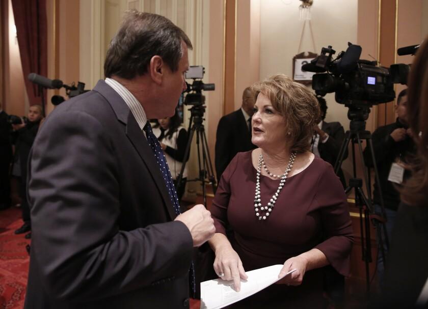 Freshman state Sen. Shannon Grove, R-Bakersfield, right, talks with Sen. Scott Wilk, R-Santa Clarita, during the state Senate session Dec. 3 in Sacramento.