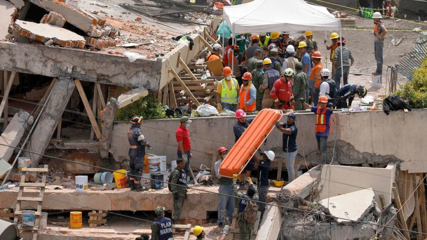 The Enrique Rebsamen school collapsed in Mexico City during Tuesday's earthquake. At least 25 bodies were carried out — 21 were students, believed to be 7 or 8 years old.