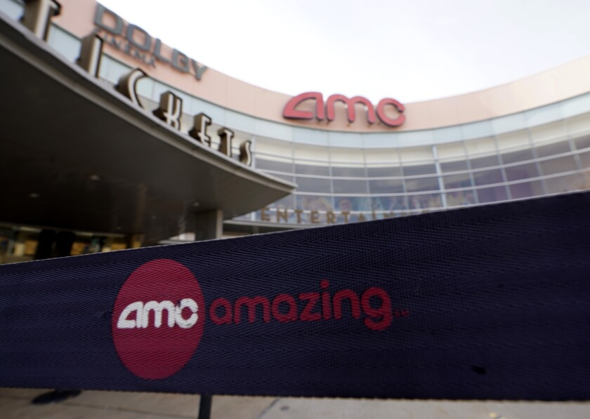 FILE - This Jan. 29, 2021, file photo, shows an AMC movie cinema in Garland, Texas. GameStop and other meme stocks, such as AMC, are soaring again. Much of professional Wall Street said earlier in the year that the phenomenon would likely fizzle out in time, particularly after the smaller-pocketed and novice investors behind it felt the pain of losing their money. AMC Entertainment has set records recently. (AP Photo/LM Otero, File)