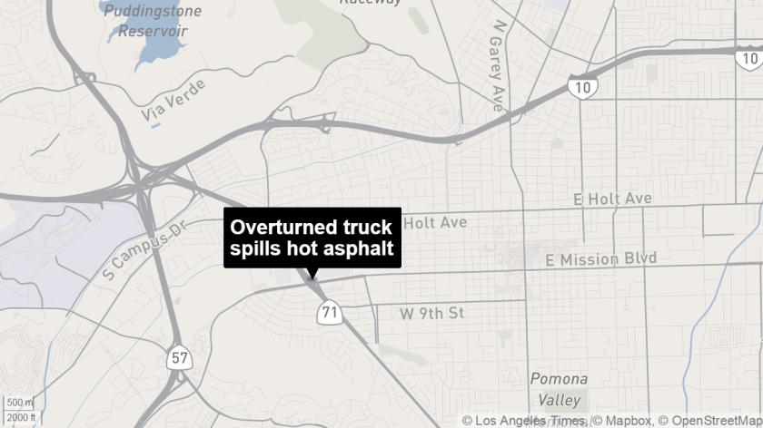 An overturned truck spilled hot asphalt on the 71 Freeway in Pomona on Friday morning.