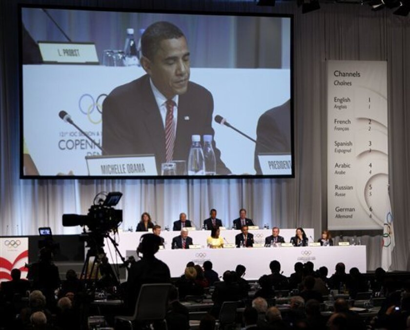 U.S. President Barack Obama is seen on a video screen during the USOC's pitch for Chicago to host the 2016 Summer Olympics, Friday, Oct. 2, 2009, at the 121st International Olympic Committee Session in Copenhagen, Denmark. (AP Photo/Gerald Herbert)