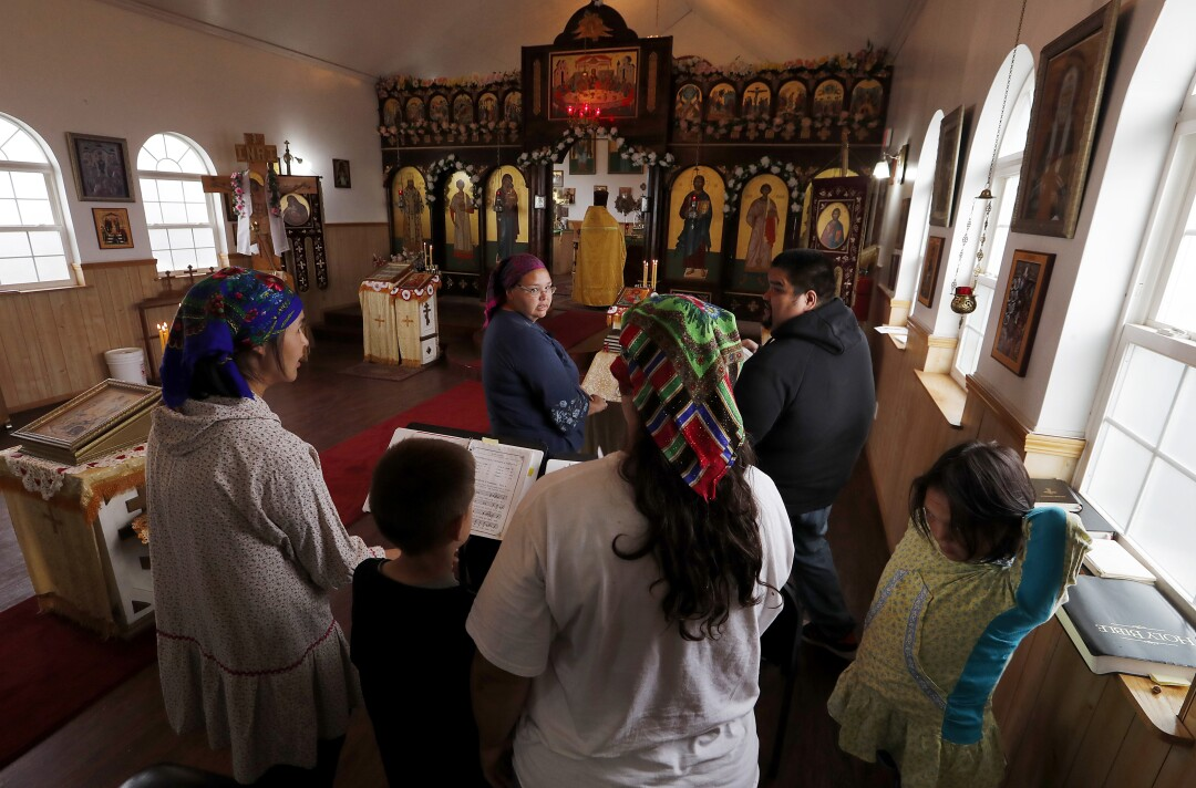 Choir members prepare to sing at the Russian Orthodox Church in Newhalen, Alaska.