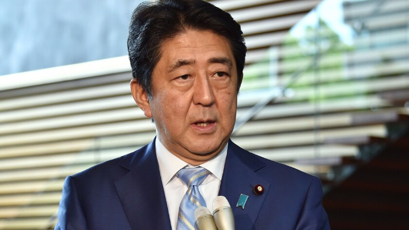 Japanese Prime Minister Shinzo Abe speaks to reporters at his official residence in Tokyo on August 3, 2016, after a ballistic missile launch by North Korea.