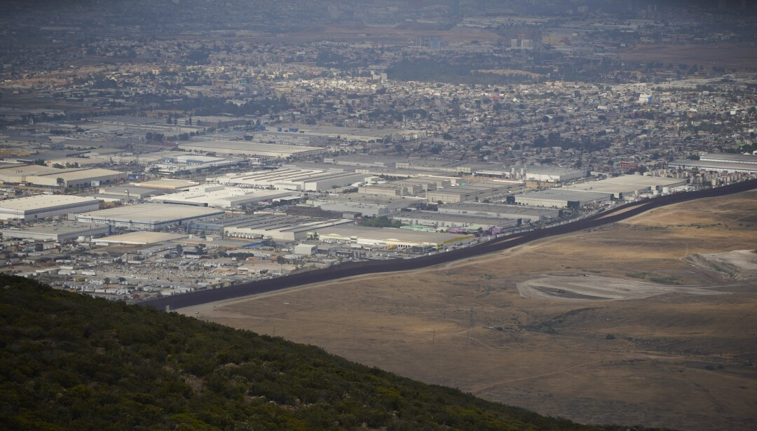 To the left of the border fence is Tijuana, Mexico, as seen from Otay Mountain.