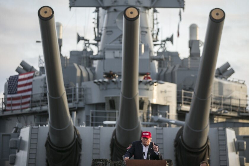 Republican candidate Donald Trump speaks from the deck of the battleship Iowa last year.