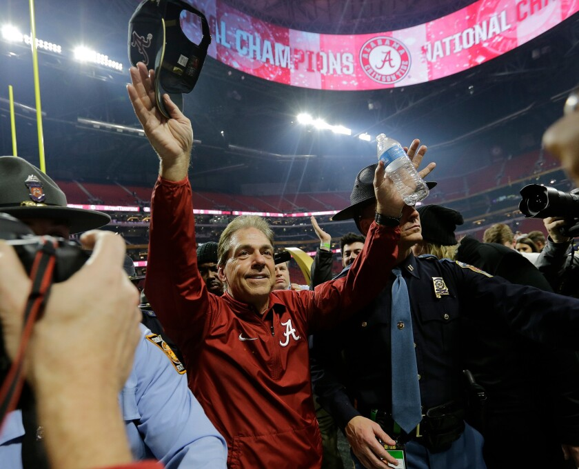 FILE - In this Jan. 8, 2018, file photo, Alabama head coach Nick Saban celebrates after overtime of