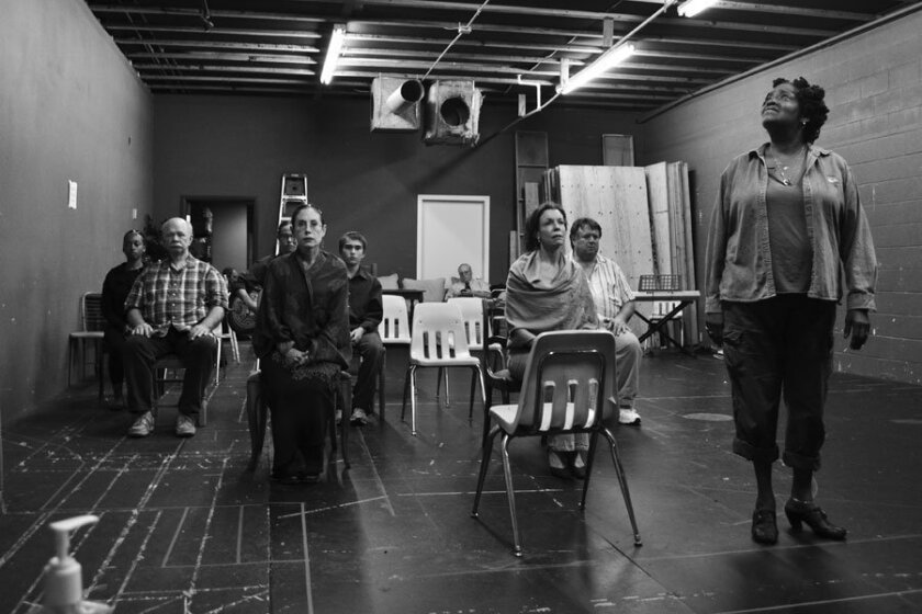 """Sylvia M'Lafi Thompson (far right), who plays the Stage Manager, runs through a scene with the cast of """"Our Town"""" at Cygnet Theatre."""