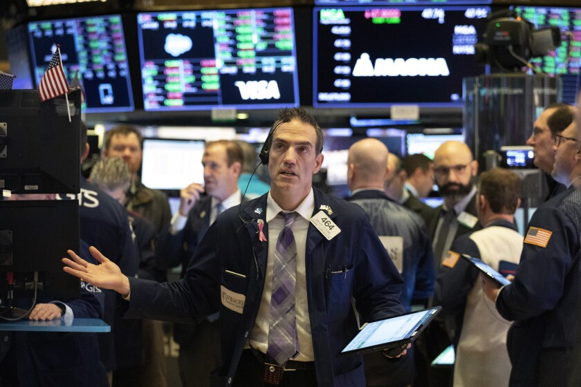 A trader on the New York Stock Exchange floor as the market falls