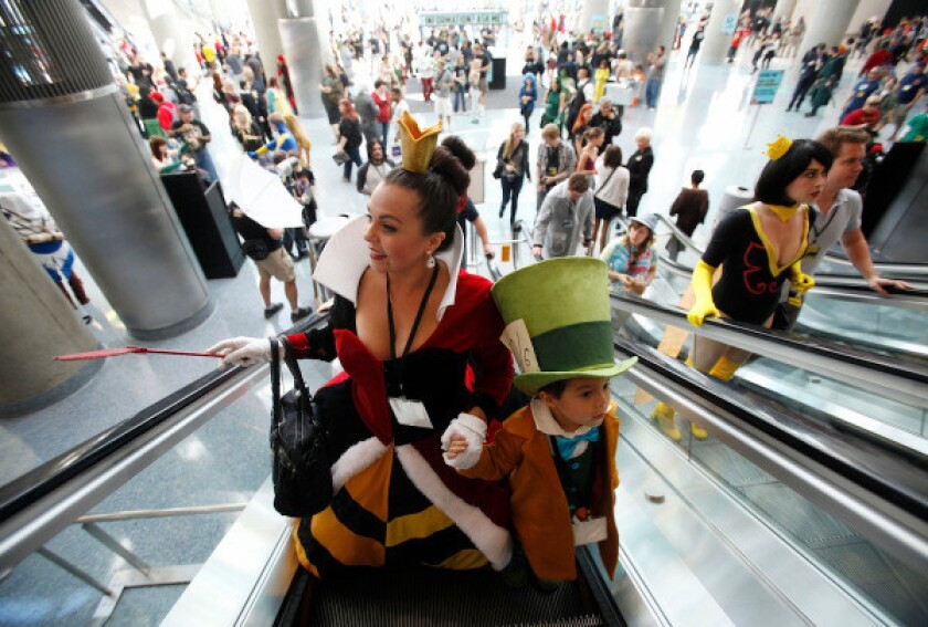 Cosplayers ride escalators in the L.A. Convention Center
