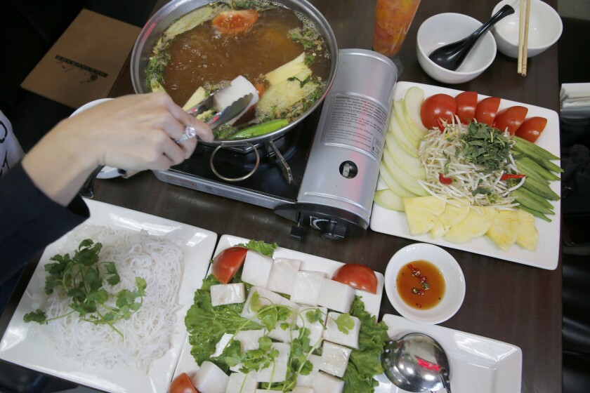 Portable propane stoves make hot pot easy to set up at home.