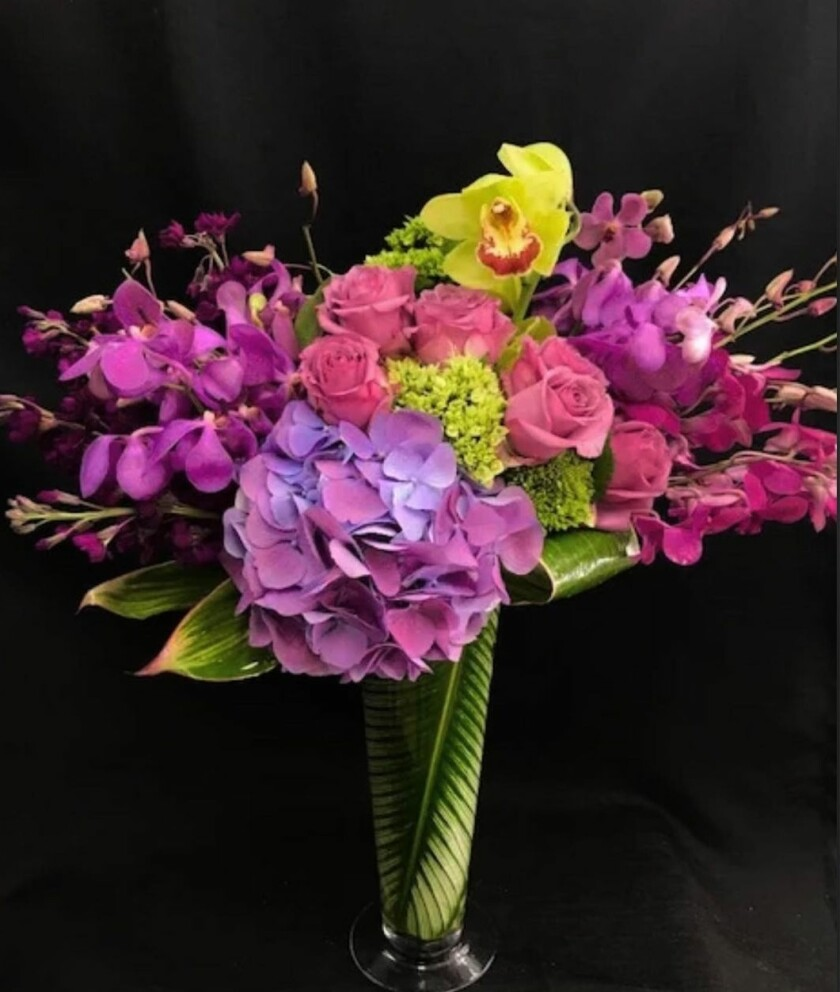 """La Jolla Florist's custom arrangements can be as small as a """"just because"""" bouquet to as large as a wedding display."""