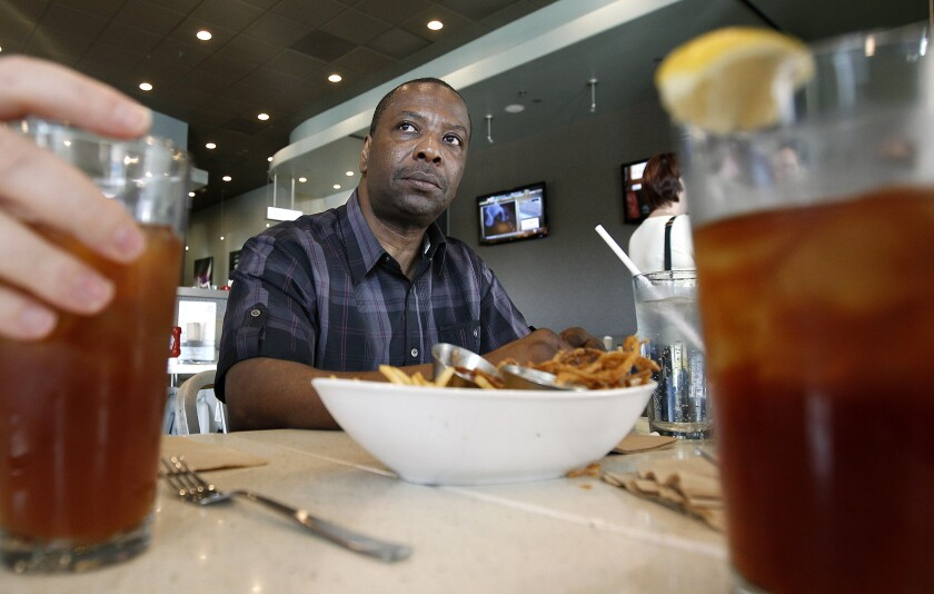Kash Register dines at a burger joint in Los Angeles in November after his murder conviction was overturned. Prosecutors say they will not refile charges.