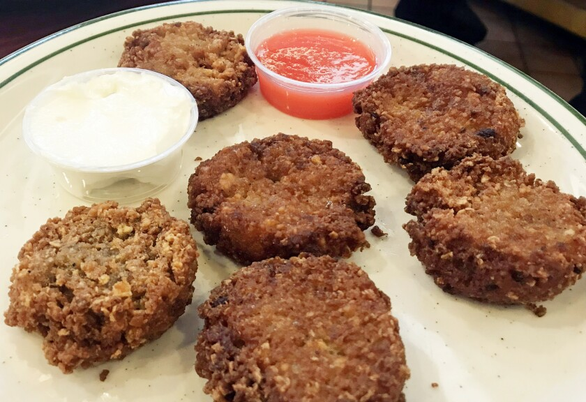 The latkes from Brent's Deli. (Jenn Harris / Los Angeles Times)
