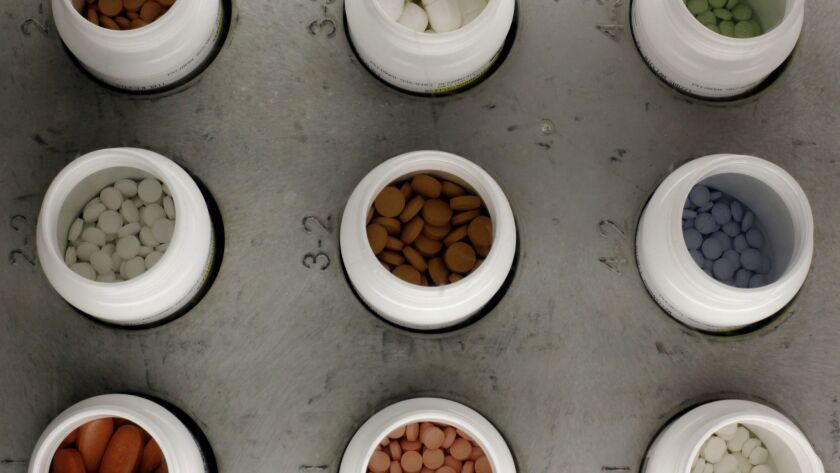 Various prescription drugs on an automated pharmacy assembly line.