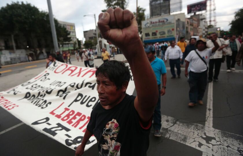Striking teachers in the southern Mexican state of Oaxaca demonstrate against education reform plans and to demand the release of two of their leaders. Six people were killed during clashes and dozens were injured.