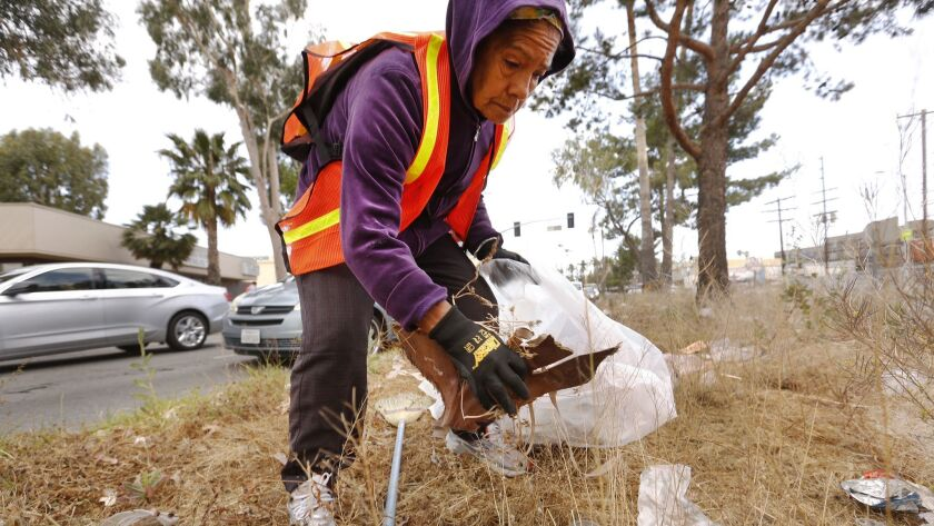 A Panorama City resident participates in a neighborhood cleanup day in 2017.