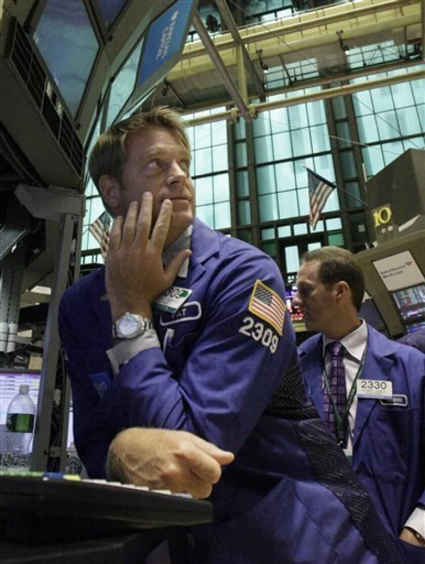 FILE - In this Aug. 11, 2010 file photograph, specialist Patrick Murphy, left, works at his post on the floor of the New York Stock Exchange. Stock futures are rising slightly Wednesday, Sept. 8, 2010, as investors try to brush off fresh worries about the health of European banks. (AP Photo/Richard Drew, file)