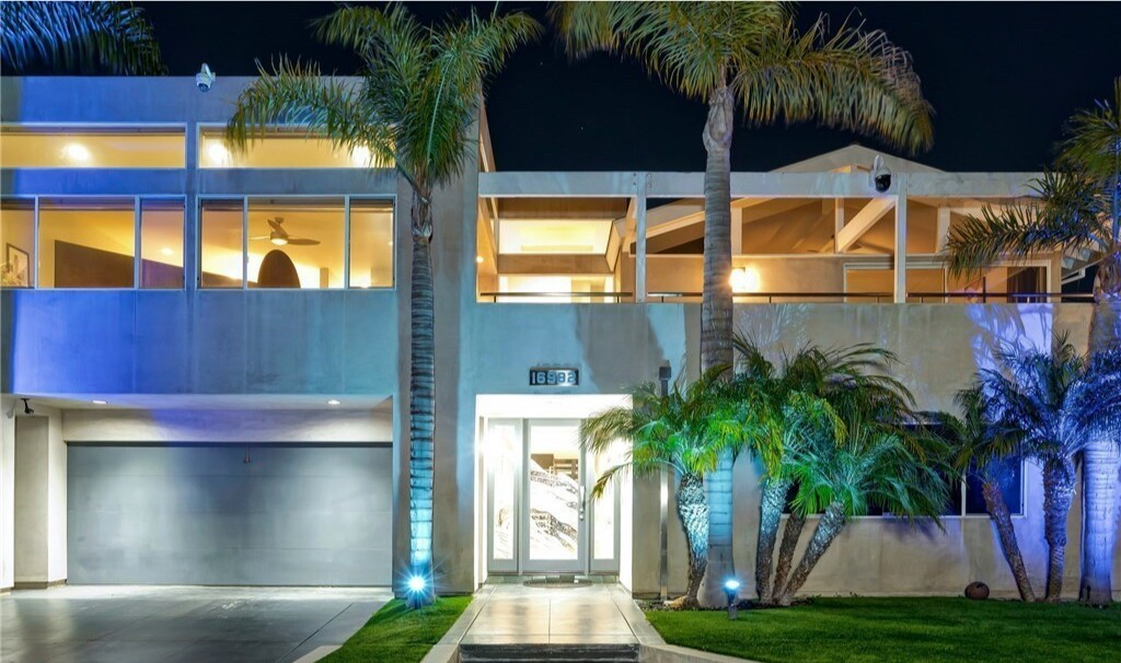 The contemporary two-story boasts a built-in aquarium and an entertainer's yard with a custom pool and spa.