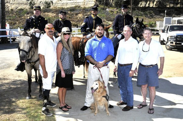 Front (L to R): Jake and Vanessa Keeslar, Miles Lichtenberg with Dusty, Bill Potter, Bronson Jacoway. Back (L to R): Cavalry regiment members John Roberts, Jim Garza, Jean Roberts, Jim McCrystal