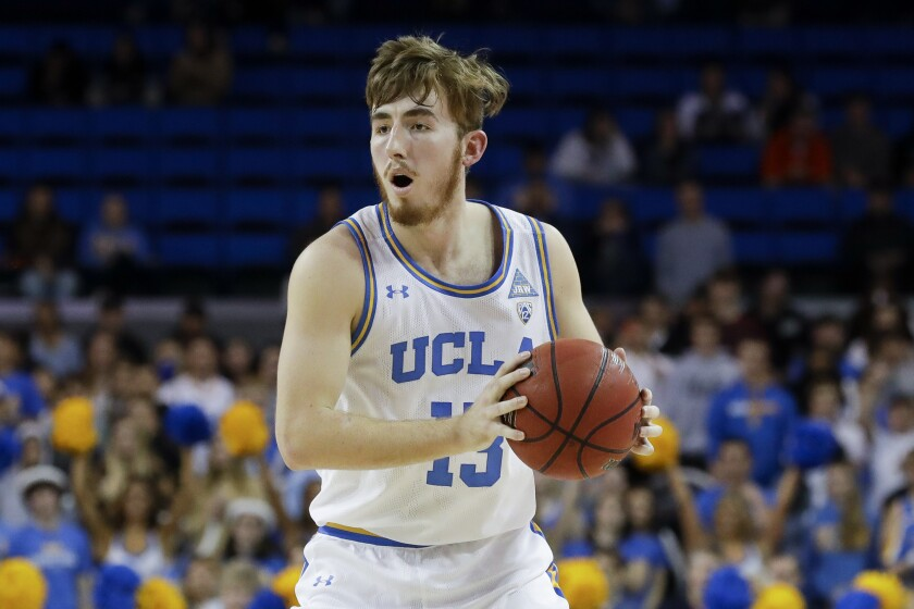 UCLA guard Jake Kyman looks to pass against Stanford.