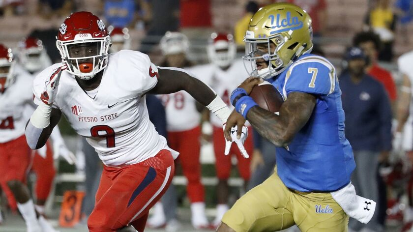 PASADENA, CALIF. - SEP. 15, 2018. Bruins quarterback Dorian Thompson-Robinson looks for room to ru