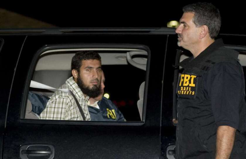 Najibullah Zazi is seen being arrested by FBI agents in Aurora, Colo., in September 2009. Zazi pleaded guilty to charges in connection with a plot to bomb the New York City subway system.