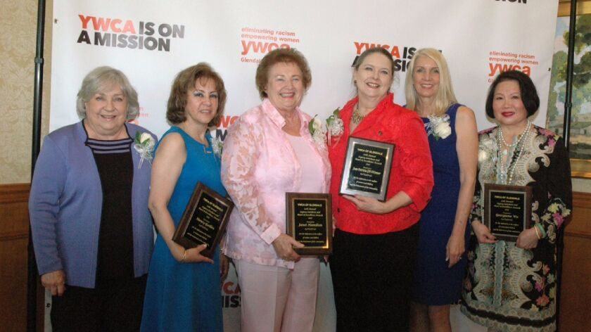 Recipients of the YWCA's Heart & Excellence Awards are, from left, Jeannie Flint, Nancy Guillen, Jan